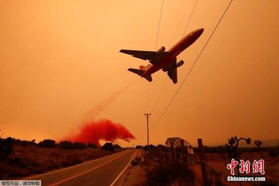 Tanker drops fire retardant to battle wildfire in California